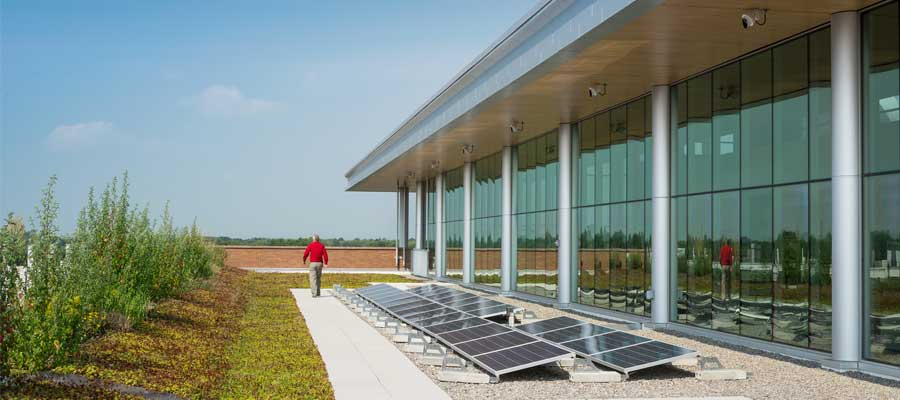 Roof of building with grass and solar panels