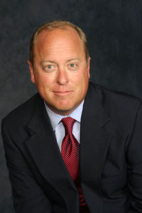 William L. Mack Joins Management Team