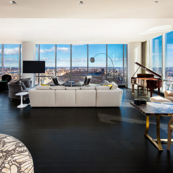 Penthouse with furnishings overlooking city skyline.