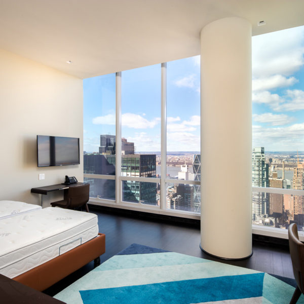 Bedroom with furnishings overlooking city skyline
