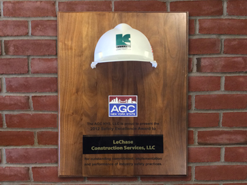 Award plaque with a LeChase hard hat mounted to it and AGC logo and verbiage