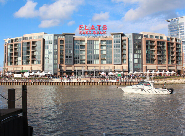 View from the river showing the entire exterior of the Flats building.