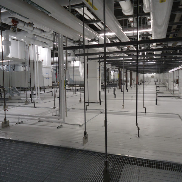 Large room with clean space for manufacturing.