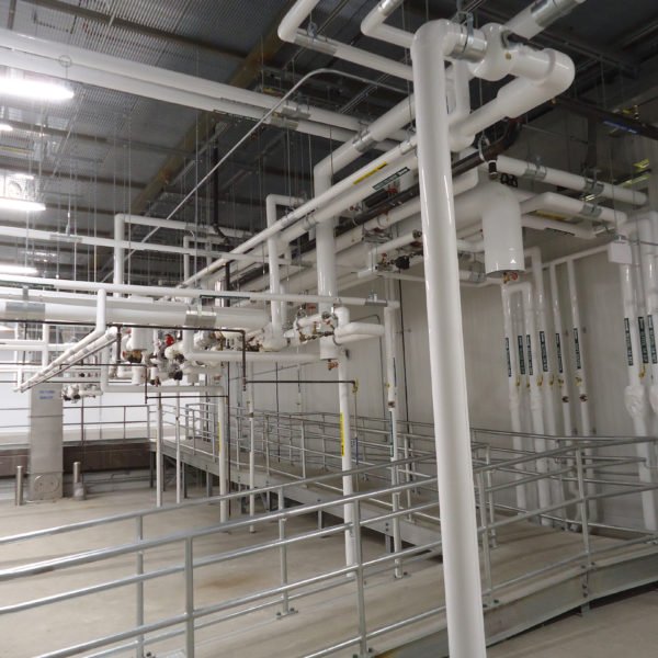 Interior of white piping and clean space for manufacturing facility.