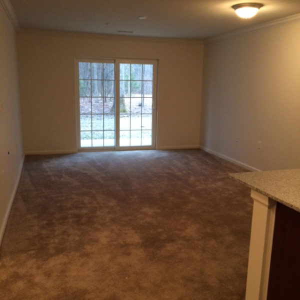 Empty room with carpet and sliding glass door