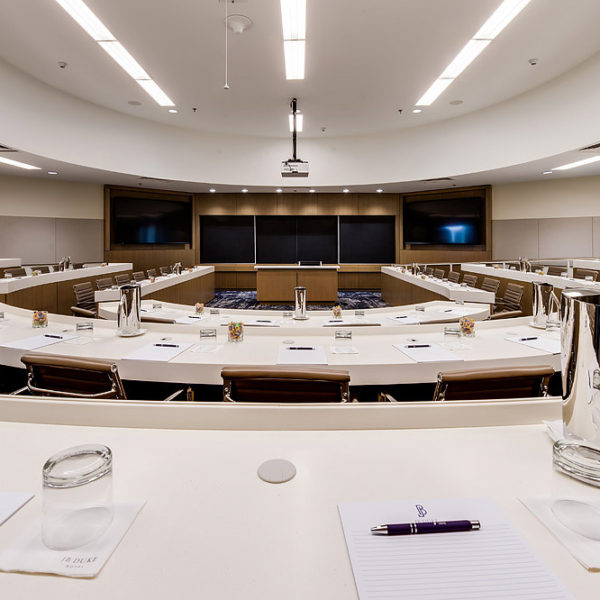 Large conference center room with semi circle tables and chairs