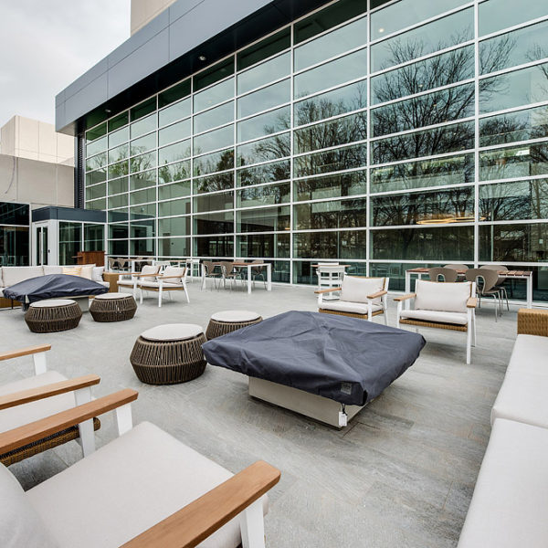 Patio with chairs, couches and fire pits