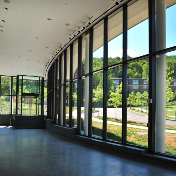Curved glass wall, showing the mountains in the distance.