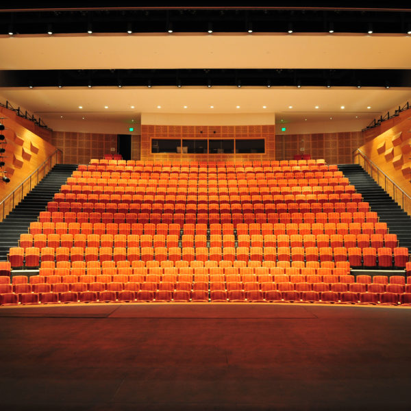 View from standing on stage facing the seats in the large auditorium.
