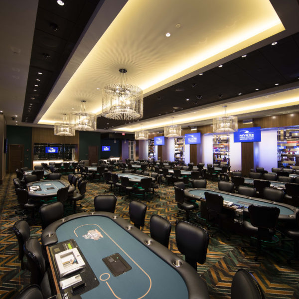 Large room with multiple poker tables
