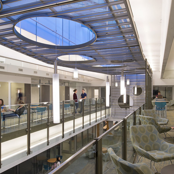 Second floor of building with chairs and students.