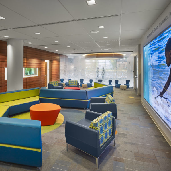 Lobby area with bright colored couches and chairs.