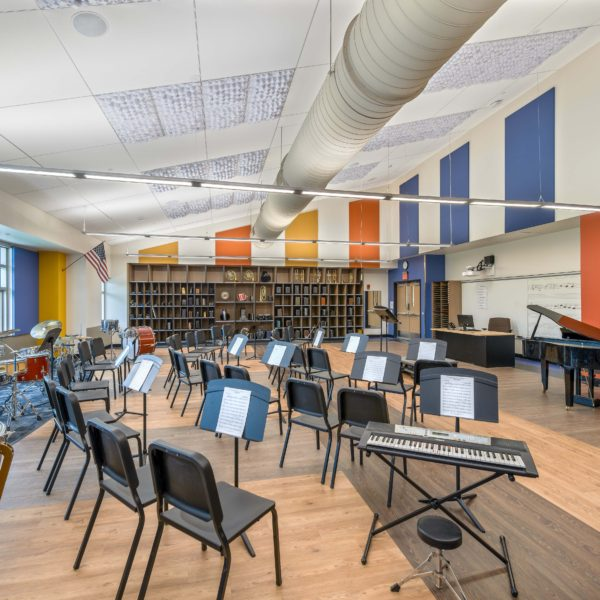 Music room with chairs, music stands and instruments