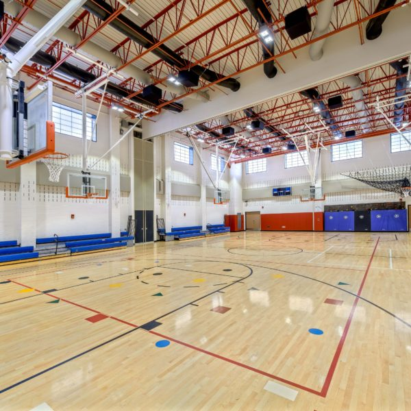 Elementary school gym with basketball hoops