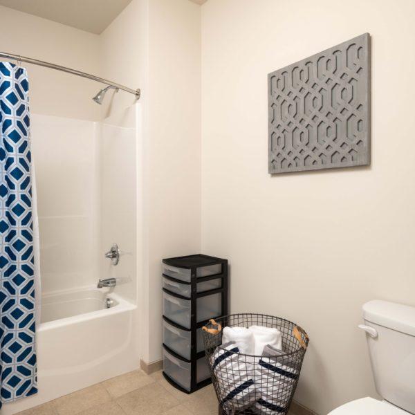 Bathroom with blue shower curtain