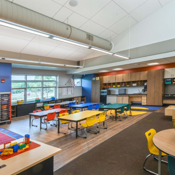 Kindergarten classroom with bright colored desks and furniture
