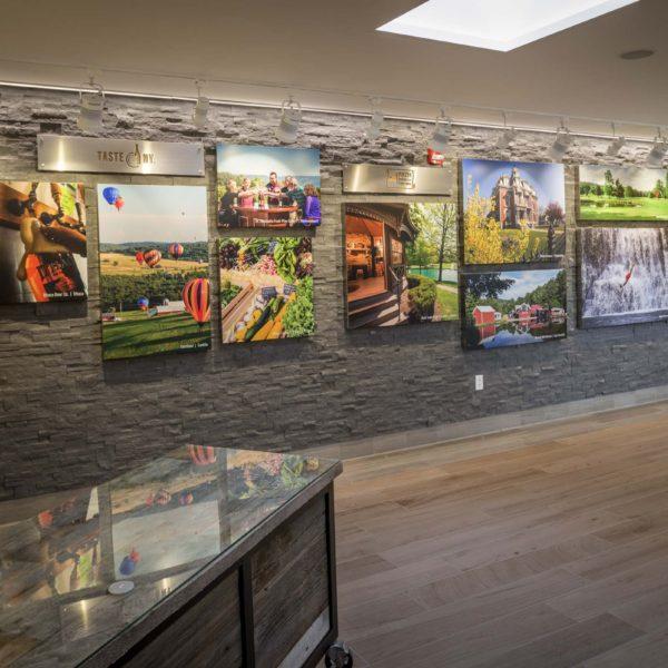 Wall with photos of NY farm products