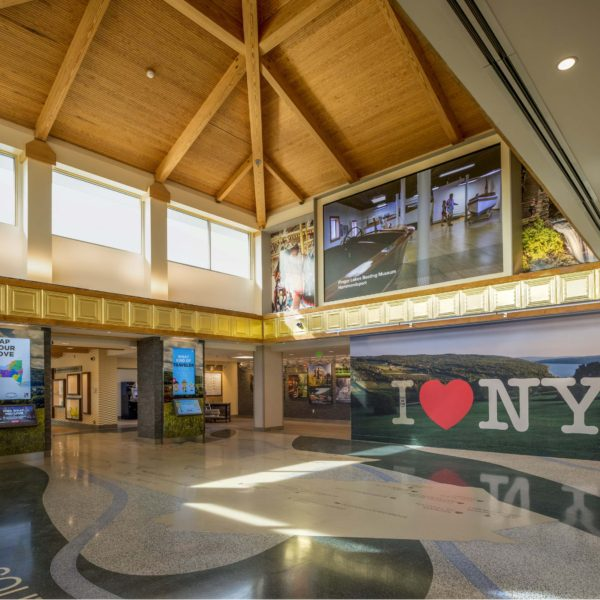 Welcome Center with I Love NY wall and wooden beam ceiling