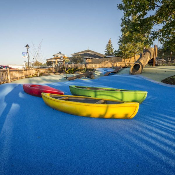 Exterior play area with canoes