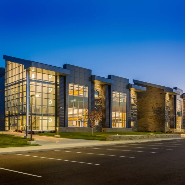 Dusk shot of school showing large glass windowns