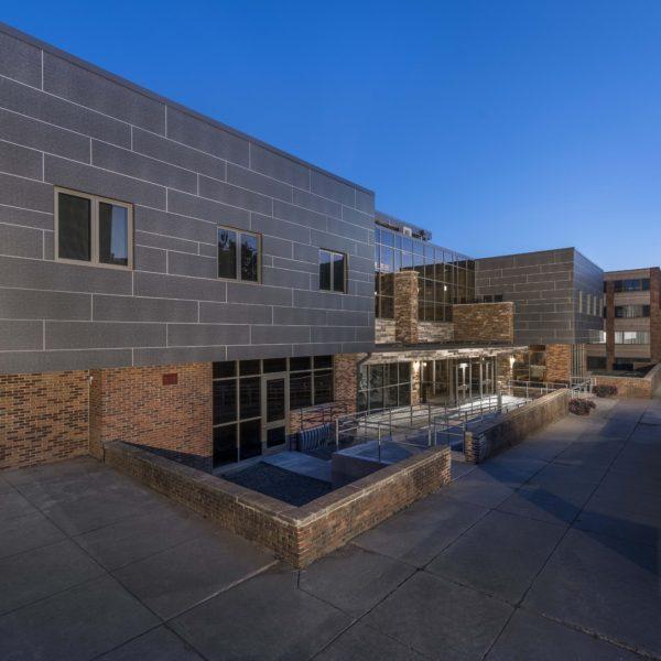 Dusk exterior of dormitory building.