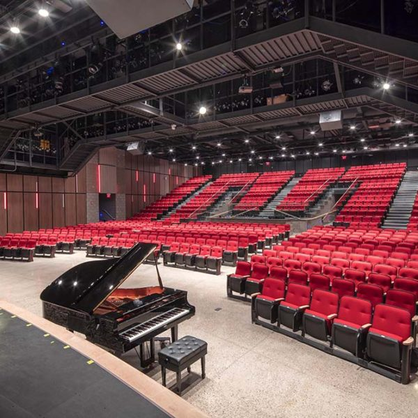 View from stage of piano and auditorium seats