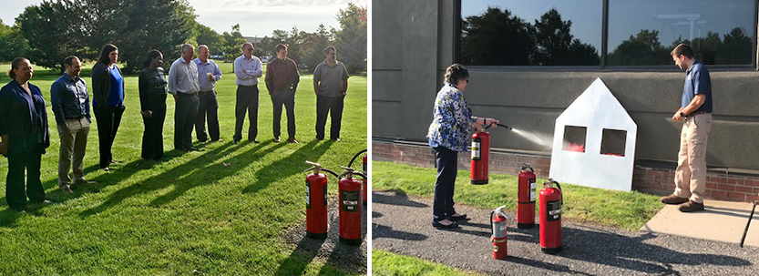 Office employees practicing use of fire extinguisher outdoors.