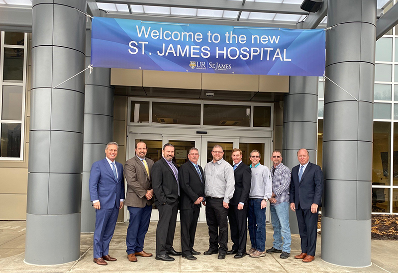 LeChase representatives in front of new St. James Hospital
