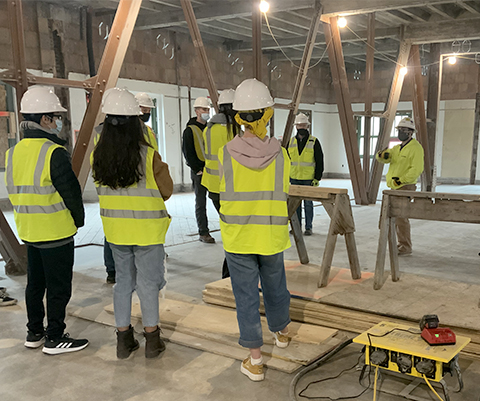 Students tour the campus project